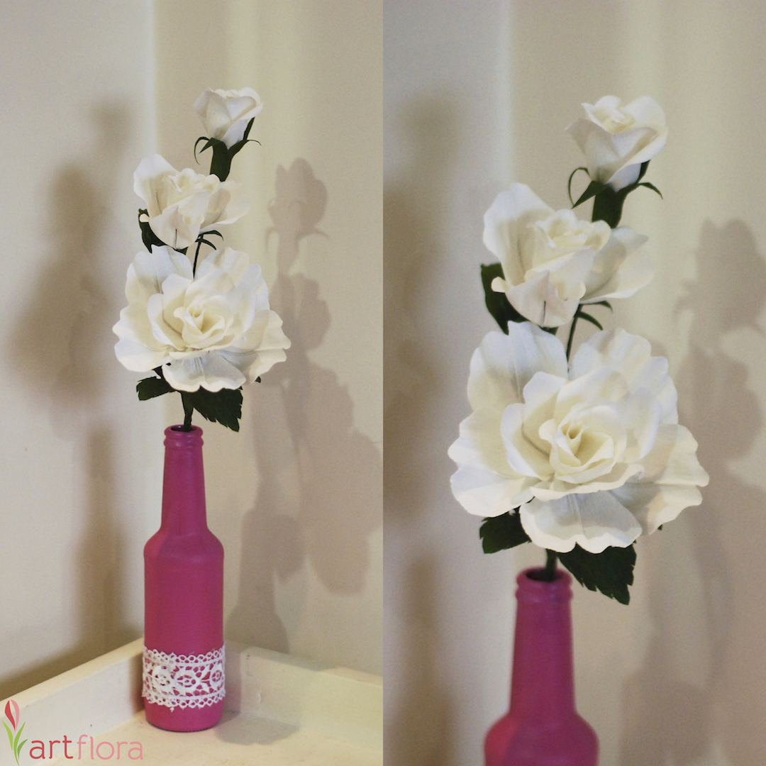 White Flower Arrangement in a Beautifully Decorated Glass Bottle